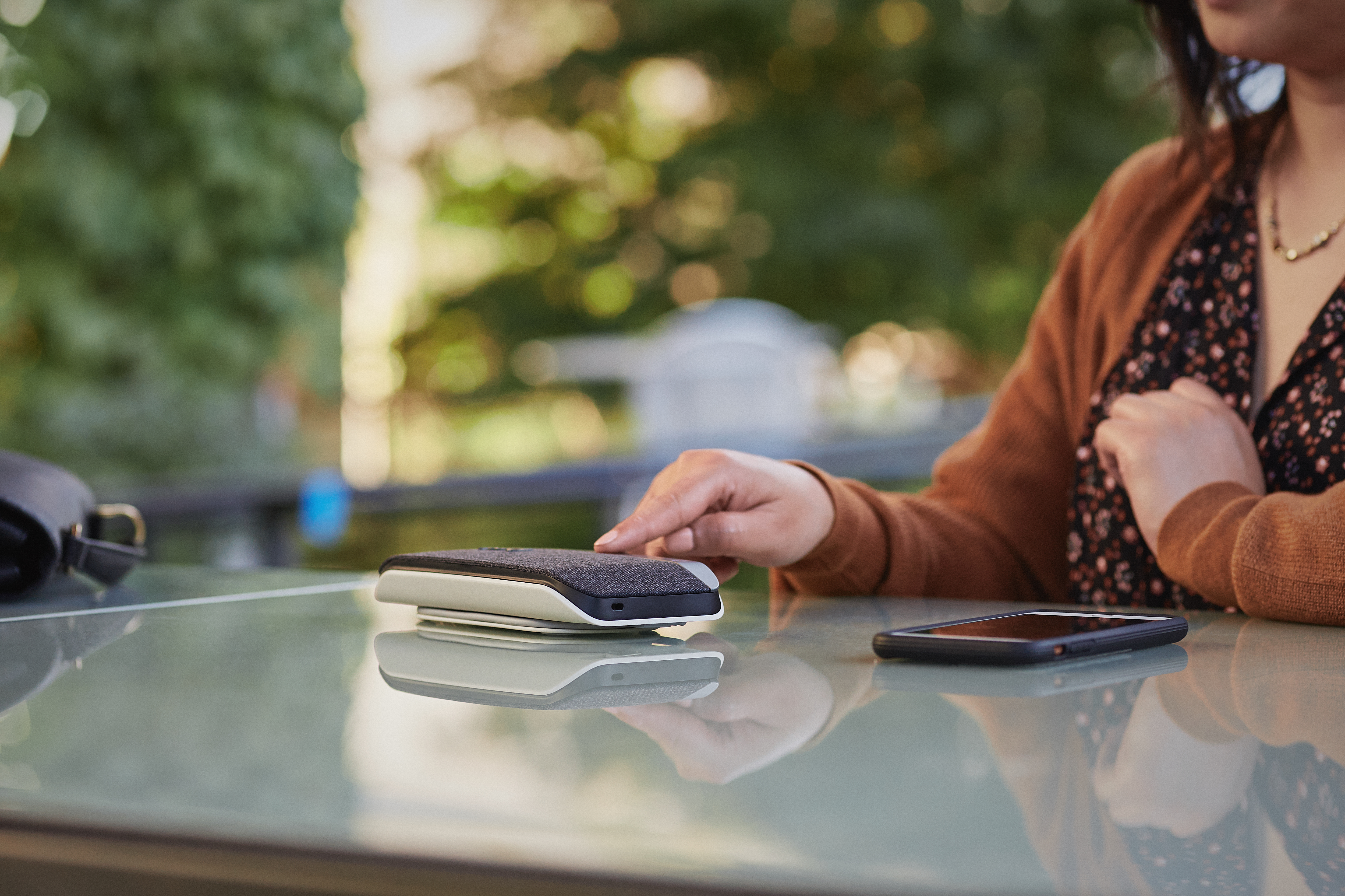 woman using Poly sync 20 outside